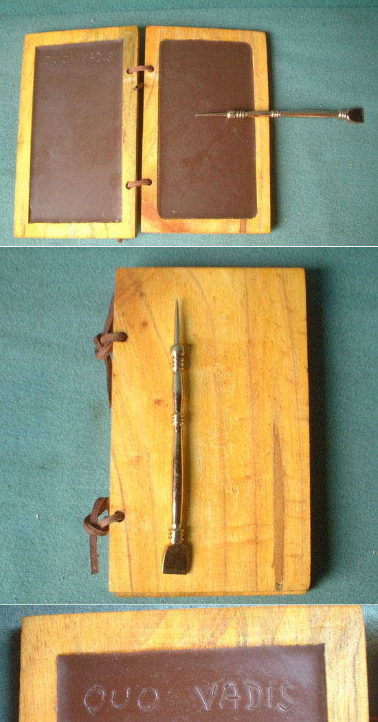 Roman legionnaire writing tablet with bronze tool